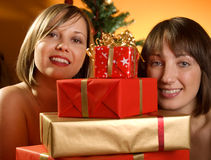 Young women with Christmas presents Stock Images