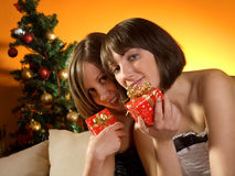 Young women with Christmas presents Royalty Free Stock Images