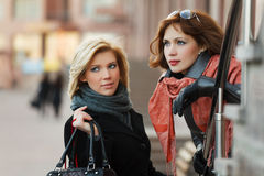 Young women on a city street Stock Photos