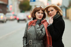 Young women on a city street Royalty Free Stock Images