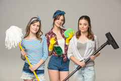 Young women with cleaning supplies Stock Images