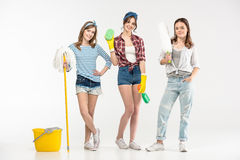 Young women with cleaning supplies Stock Image