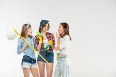 Young women with cleaning supplies Royalty Free Stock Photos