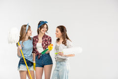Young women with cleaning supplies Royalty Free Stock Photography