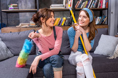 Young women with cleaning tools Royalty Free Stock Image