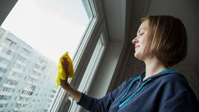 Young Women cleaning a window stock video footage