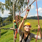People with ropes in adventure park Stock Photos