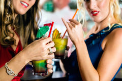 Young women with cocktails in club or Bar Royalty Free Stock Photography