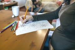 Young woman coloring mandalas Stock Image