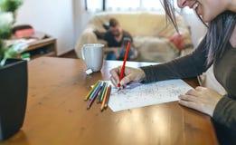 Young woman coloring mandalas Royalty Free Stock Photos
