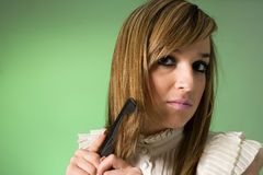 Young women combing her hair. Studio shot Royalty Free Stock Images