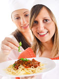 Young women cooking Stock Images