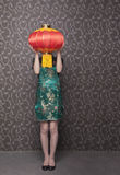 Young women covering her face with a Chinese lantern Royalty Free Stock Images