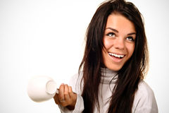 Young women with the cup of coffee. Pretty young women with the cup of coffee on white royalty free stock photo