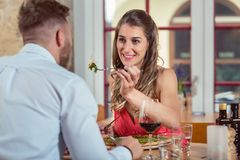 Woman feeding food to her boyfriend royalty free stock photography