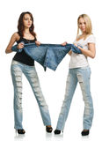 Young women depriving for jeans Stock Photos