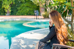 Young women are discussing. Young woman are discussing business poolside Royalty Free Stock Images