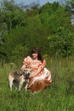 Young Women with dog. The girl in the pink with peach dog Royalty Free Stock Images