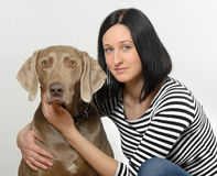 Young women and dog Stock Photos