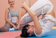 Young women doing bending exercises Stock Images