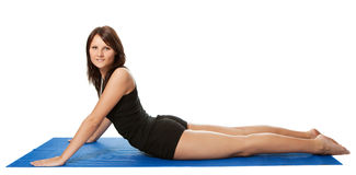Young women doing core stretch on fitness mat Stock Image
