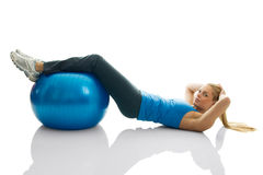 Young women doing crunches on fitness ball. Isolated on white Stock Image