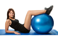 Young women doing crunches on fitness ball Royalty Free Stock Photography