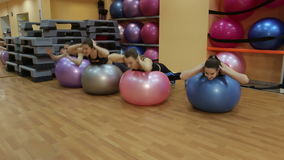 Young women doing exercise with balls. stock video