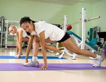 Woman at the fitness club. Young women doing exercises at the fitness club Stock Photography