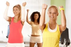Young women doing exercises Stock Photo