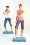 Young women doing fitness exercise Stock Images