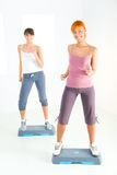 Young women doing fitness exercise Stock Photo
