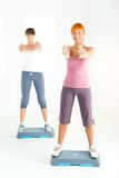 Young women doing fitness exercise Stock Photos