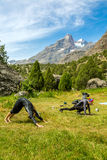 Young women doing morning fitness in mountain Stock Image