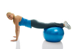 Young women doing pushups on fitness ball Royalty Free Stock Images
