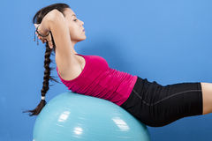 Young women doing pushups on fitness ball. Stock Image