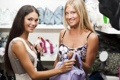 Young women doing shopping Stock Photos
