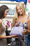 Young women doing shopping Stock Image