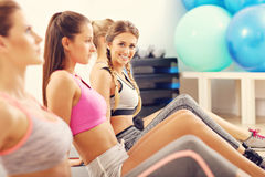 Young women doing sit-ups in a gym Stock Image