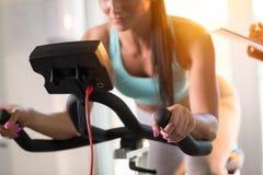 Young women doing sport biking Stock Photos