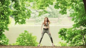Young women doing yoga exercise standing stock video
