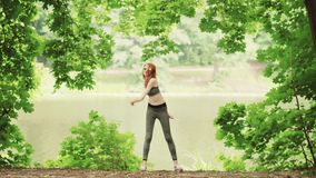 Young women doing yoga exercise standing stock video footage