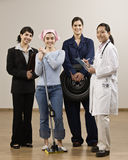 Young women dressed in various occupations Royalty Free Stock Images