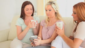 Young women drinking coffee stock video footage