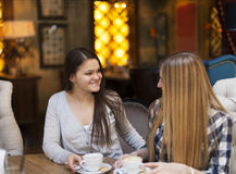 Young women drinking coffee in a cafe Stock Photo