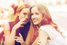 Young women drinking coffee and talking at cafe Stock Photos
