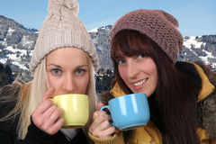 Young women drinking cup of tea outdoor in the mountains Stock Photo