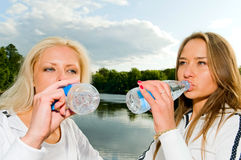 Young women drinking water Royalty Free Stock Photo