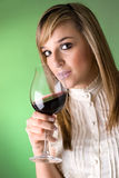 Young women drinking wine. Studio shot Stock Photography