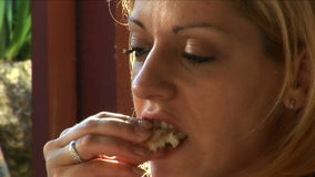 Young women eating stock footage